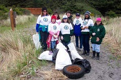 Volunteers at Cape Disappointment State Park with collected garbage