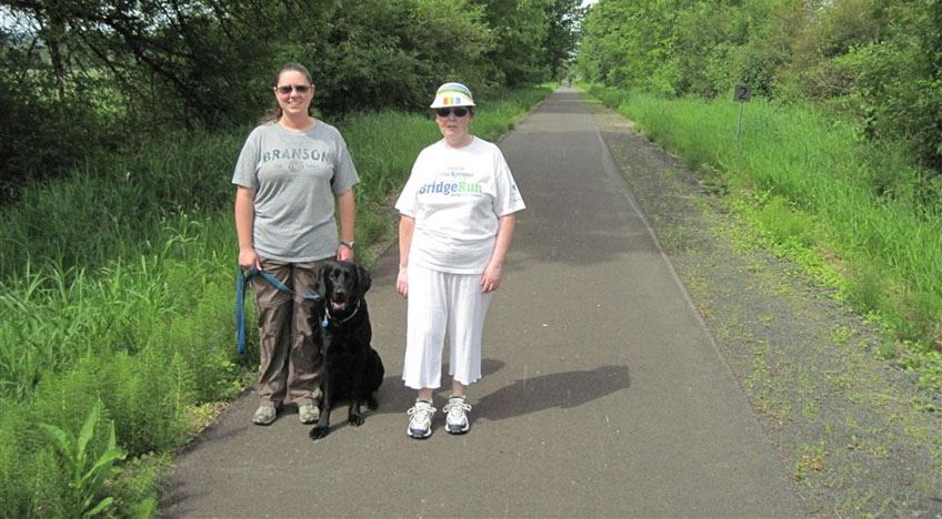 Willapa Hills Trail - people on paved trail with dog