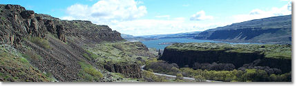 View from atop the steep basalt cliffs of the Columbia River down to the river gorge