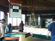 Visitors at Lewis and Clark Interpretive Center viewing maps and artifacts