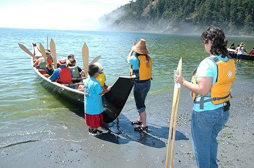 People get ready to take a ride in a traditional tribal canoe at Deception Pass State Park